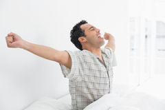 http://www.dreamstime.com/stock-photo-young-man-stretching-his-arms-bed-side-view-happy-waking-up-image37190620